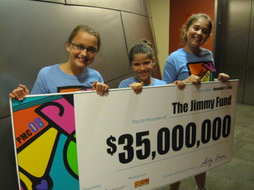 PMC Kids Riders Emma Zeiger, Sami Swartz, and Allison Lebwith, all of Needham, offered a hand in presenting the $35 million donation.