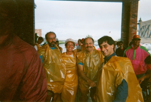 Jose Rodriquez, Brenda White, Bill Indresano, and David Brown trying to stay dry in 1989