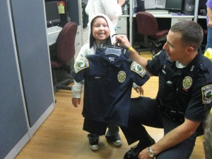 Connor shows off his official police uniform
