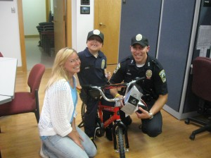 Connor with mom Lindsay and Derek and a brand new bike, a gift from the chief